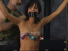 Young slave connected with sexy bikinis acquire strapped and blindfolded by grown up dextrous