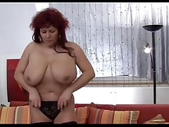 Redheaded mammy showing her superhuge tits