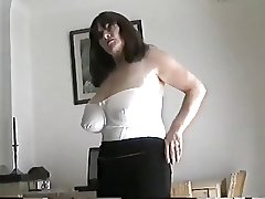 Full-grown milf with large tits rubbing the brush pussy