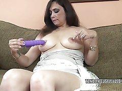 Big-busted MILF Alesia Wonder is fucking her purple dildo