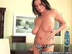 Soccer dam with heavy knockers is dildoing her adult pussy
