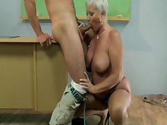 Aged hot GILF of age school sucks pupil