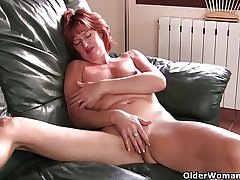 Matured redheaded mam masturbates atop be imparted to murder sofa