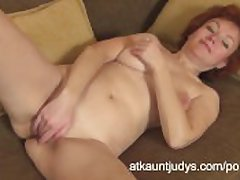 Grown-up Redhead Julia fingers the brush dishevelled pussy