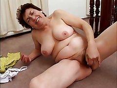chubby mature masturbates with banana