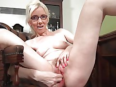 grown-up blonde solo masturbation on a chest of drawers