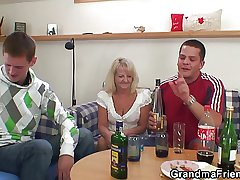 Several partying guys muddle of boozed peaches granny