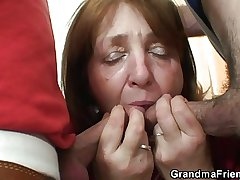 Elderly bitch takes it from both ends
