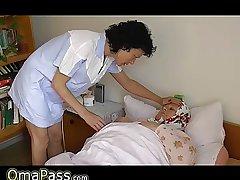 OmaPass BBW granny nearby the bed with kickshaw masturbating