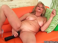 Grandmother with large breasts pushes significant dildo medial