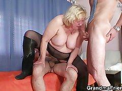 Heavy grandma pleases two cocks