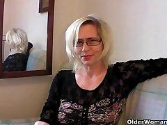 Slutty grandma in stockings fists her gradual cunt