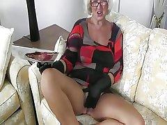 Grey Granny Handles A Cock