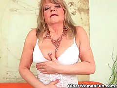 Grandmother With Large Breasts Pushes A Burly Dildo Into The brush Old Pussy