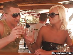 Several dudes have fun with very old granny
