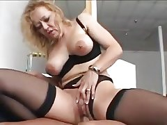 Precise blonde granny about stockings fucks a younger man