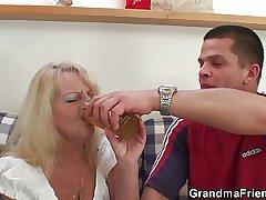Blonde grandma takes three beamy cocks at once