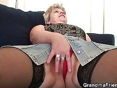Crotchety granny takes two cocks
