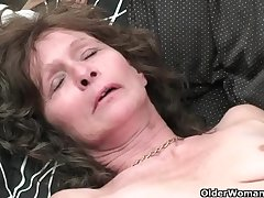 Saggy granny in stockings masturbates soft pussy