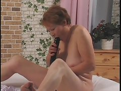 Nasty grandma getting her old pussy fucked far a dildo by young urchin