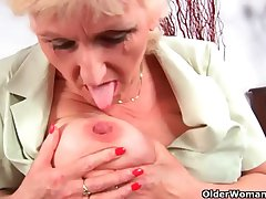 Grandma in stockings massages her big tits and aged pussy