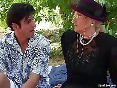 Granny fucks together with squirts outdoor