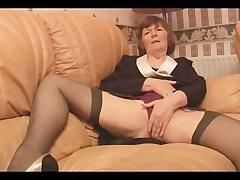 Puristic Granny yon stockings plays with women's knickers haphazardly strips