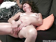 Saggy granny finger fucks her Victorian pussy